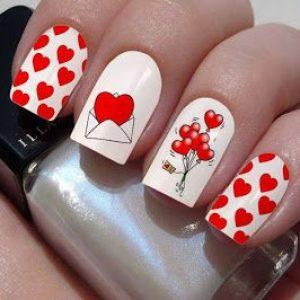 uñas blanco y rojo san valentin