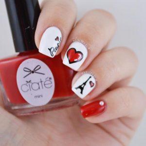 uñas rojo y blanco con corazon