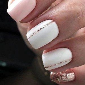 uñas blancas con detalles rosa